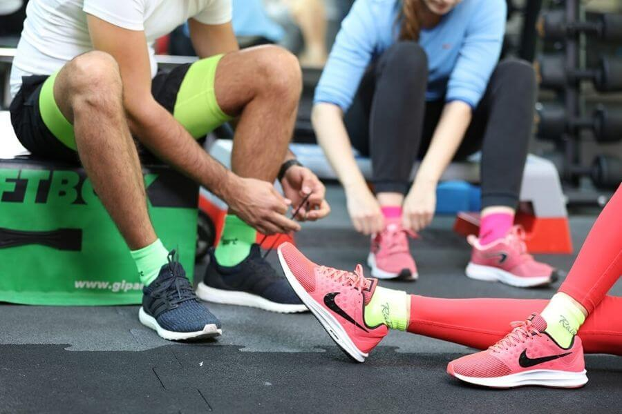 Group of people at the gym, wearing colourful socks and shoes