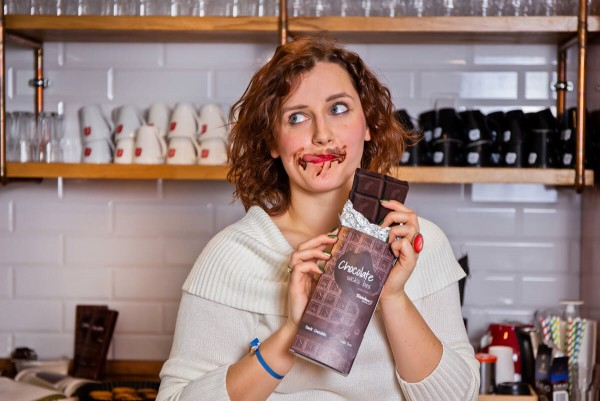 A woman eating chocolate, dreaming of Chocolate Socks on Valentine's Day