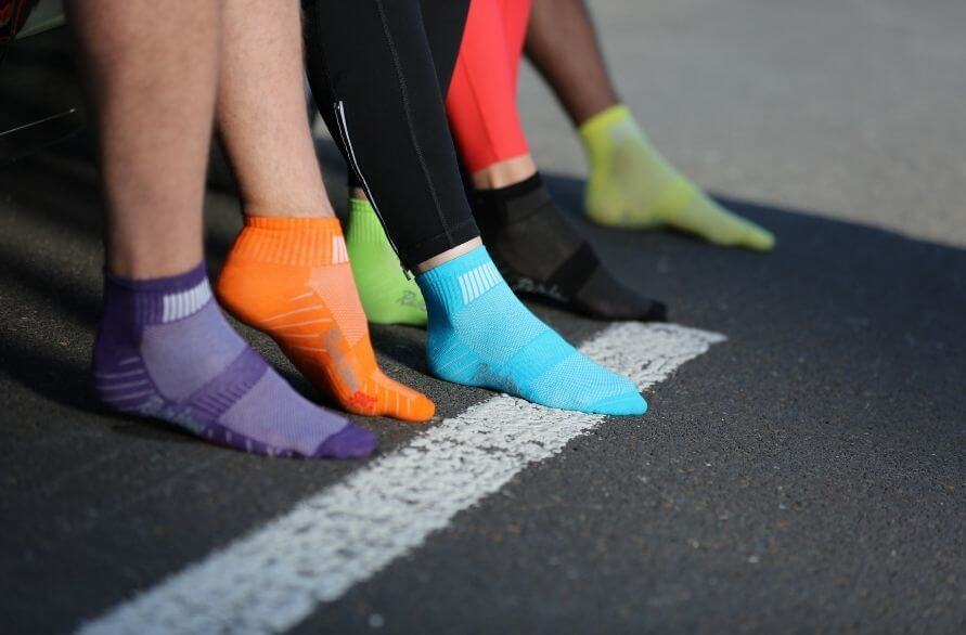 Sport Can Change the World - Runners in classic Rainbow Sneaker Socks